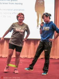 Ying Rong (right) teaches the audience how a simple theraband can help strengthen one's butt muscles.