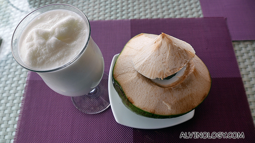 Coconut milkshake and fresh coconut water by the pool