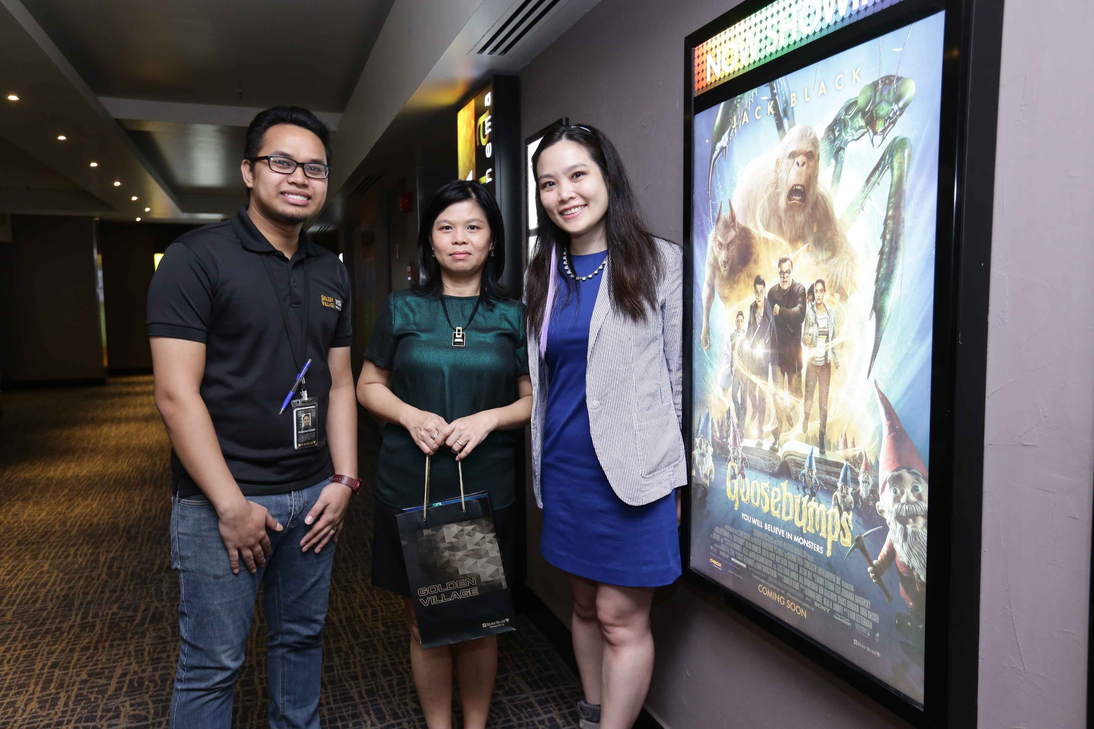 (L-R) Md Zulfadhli, Duty Manager, Golden Village Bishan; Tan Bee Heong, General Manager, The Straits Times School Pocket Money Fund; and Bianca Leong, Marketing and Distribution Manager, Golden Village Pictures (2)