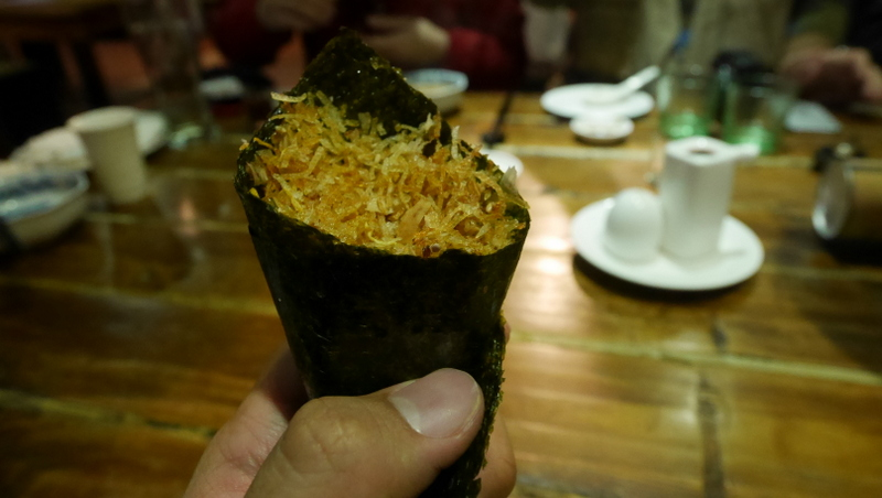 A light snack of bonito flakes and pork floss, wrapped in crispy seaweed.