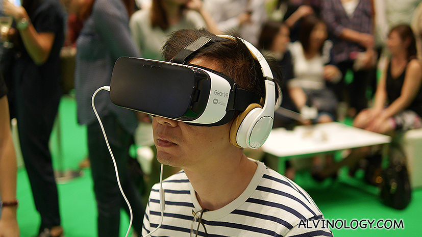 A guest watching the concert with a pair of 360 virtual reality glasses