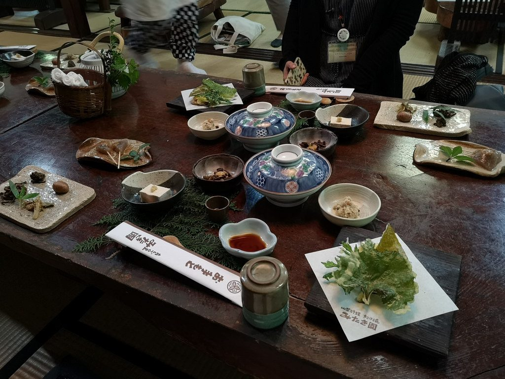 Sansai cuisine is made with local and seasonal ingredients. Observe the pine leaves being used as placemats.