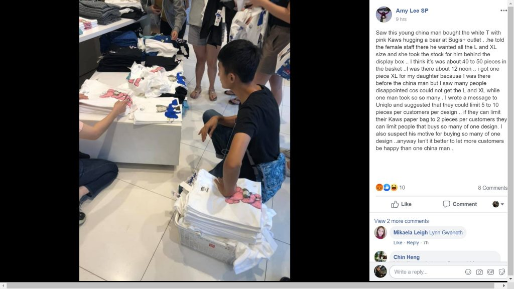 This young man was spotted putting 40 to 50 t-shirts in his shopping basket at the Uniqlo outlet in Bugis+ at 12noon. (Credit: Facebook)