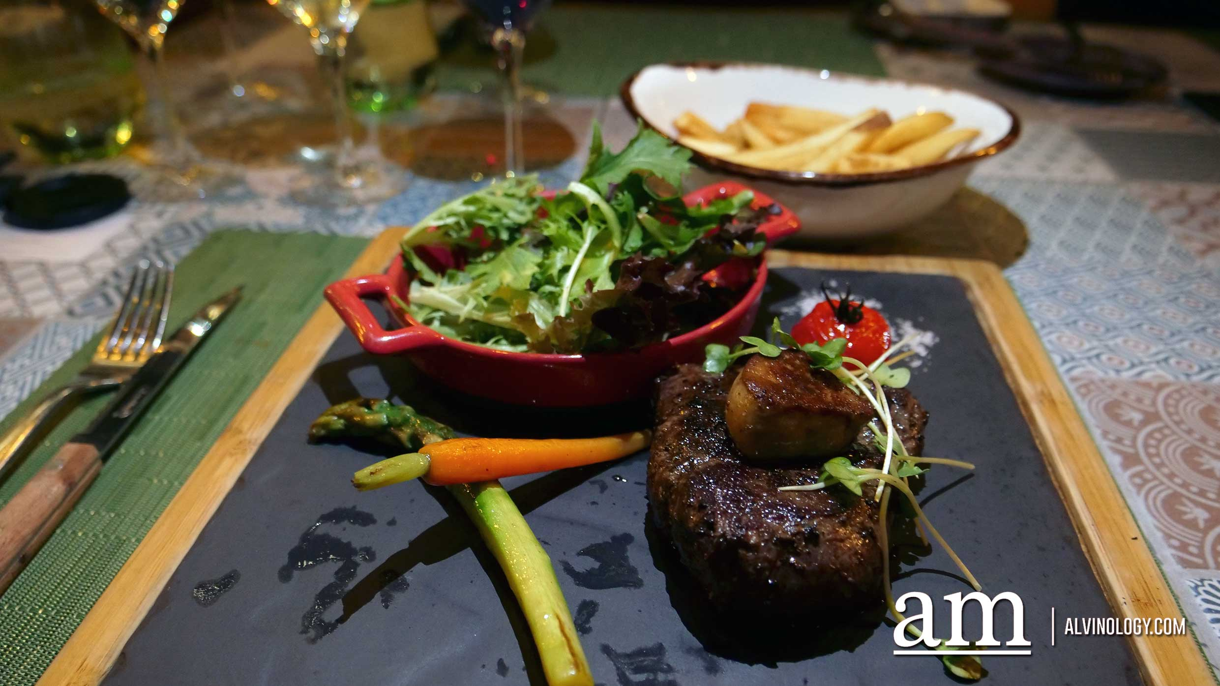 Beef Tenderloin 250g (sampling half portion) - 150-days grain-fed MS2+ beef tenderloin evenly-seared and served with foie gras, vine tomatoes and asparagus with a side of handmade green peppercorn sauce, $87