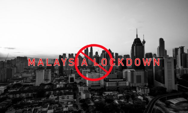 What happened to Malaysian workers in Singapore on day 1 of their lockdown?